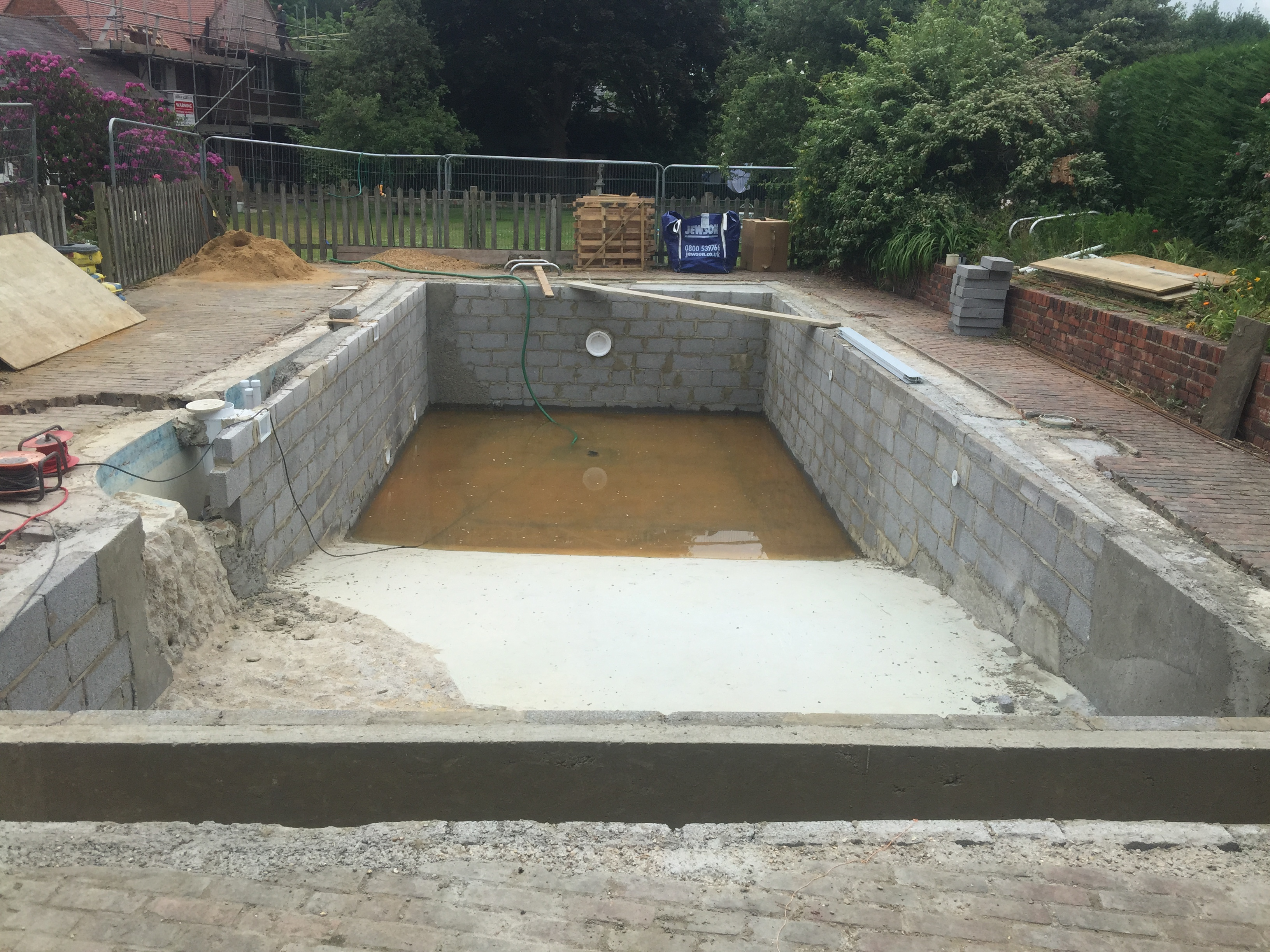 Remodelled outdoor concrete swimming pool chobham surrey - Cinder block swimming pool construction ...
